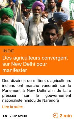 Economie des agriculteurs convergent sur new delhi pour manifester page001
